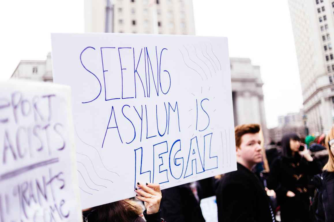 Rally sign that says: Seeking Asylum Is Legal